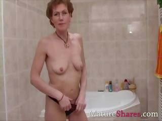 bushy mature pees and takes a shower