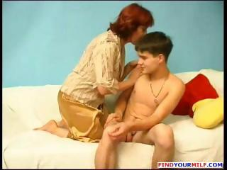 older bulky russian redhead gives this young boy
