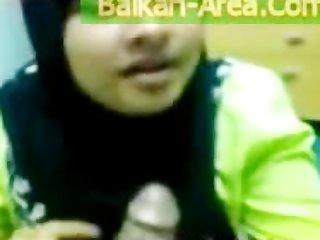 devout pakistani wife in black burqa engulfing
