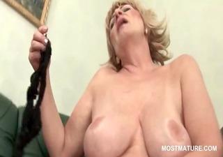 naughty golden-haired mature pushing her panties