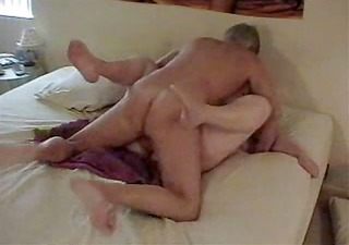 older guy having sex with wife on bed wear-tweed