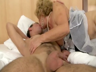 aged granny in lingerie sucks cock then rides