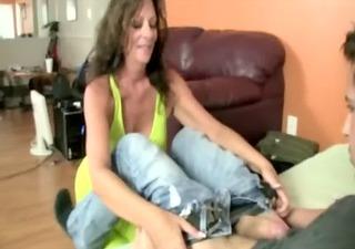 horny mature likes giving boytoy a handjob