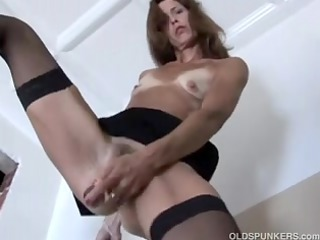 bewitching older red head in nylons
