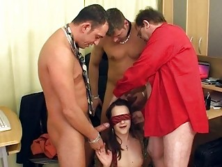aged brunette with the glasses having a group sex