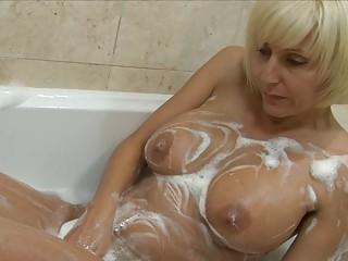 playful blonde milf with large bosom plays around