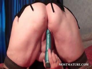 blonde older tramp licking her big titties