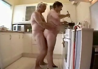 granny and older man having fun in the kitchen