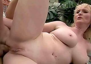 busty grandma enjoys anal sex