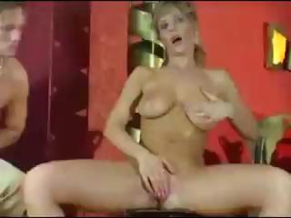busty golden-haired milf gives a boob job and
