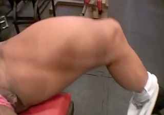 tanned muscle woman working out her pussy