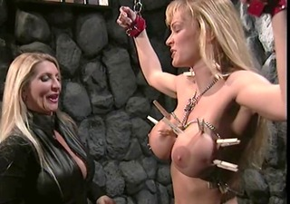 busty madam in bdsm action with a hot large boobs